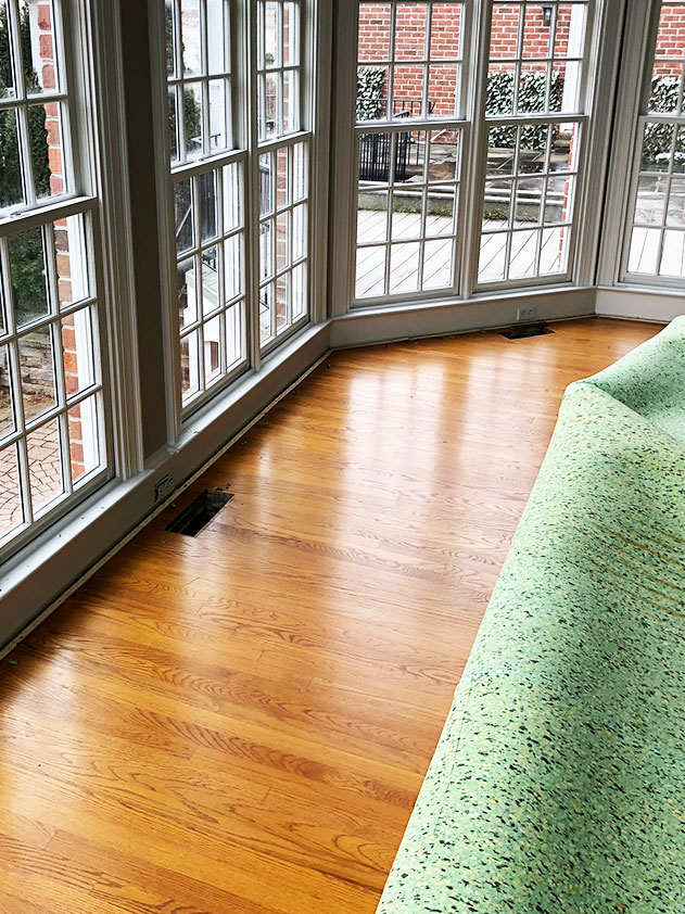 Before we could refinish red oak flooring in our house, we removed the old carpet