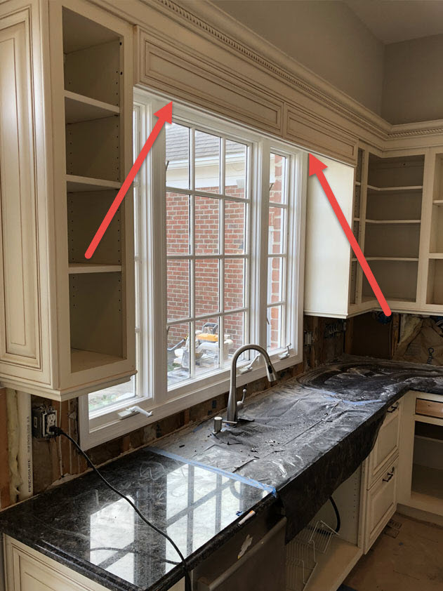 The extra piece of cabinet trim above the sink was removed to open the space up