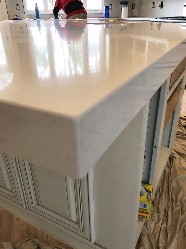The island countertop has a 2.5 inch mitered edge