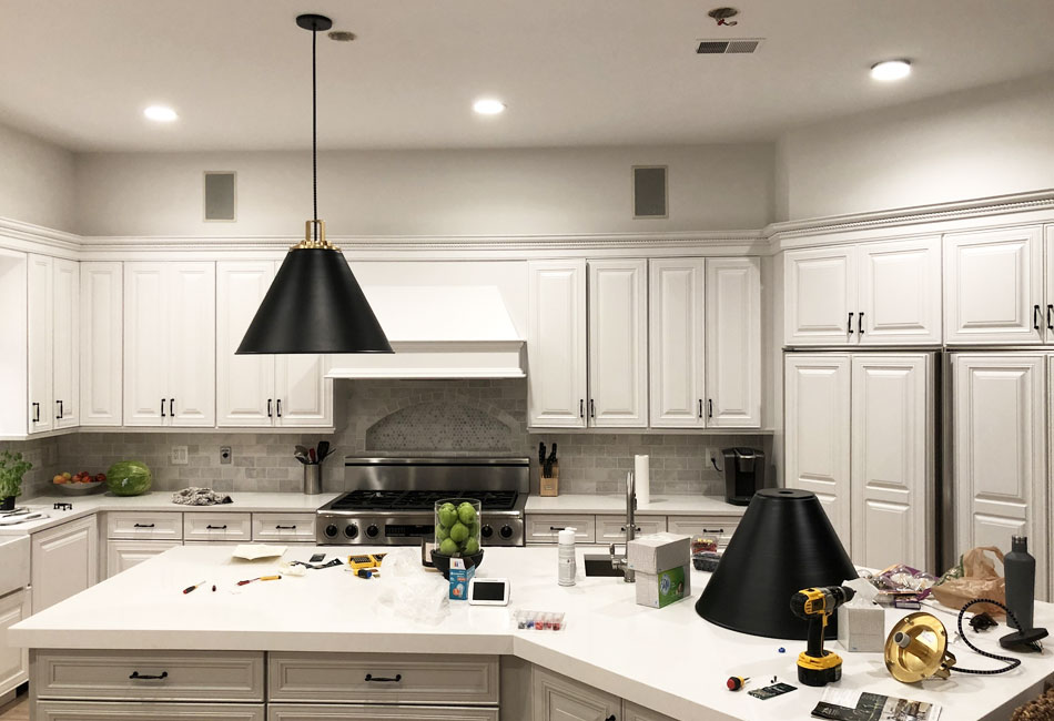 We installed new pendent lighting above the island