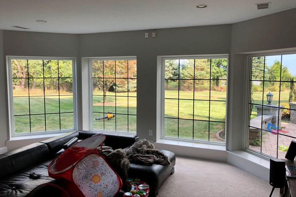 The basement windows with black grilles.