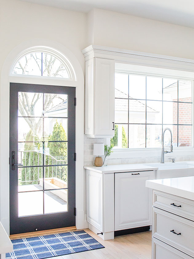 The kitchen received a new door with black grilles and a large black grille window over the sink.
