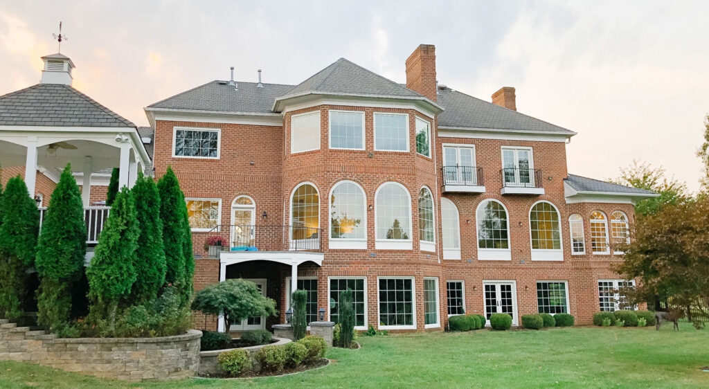 The Arched Manor with new black windows!